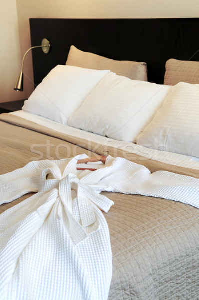 Hotel bed with bathrobe Stock photo © elenaphoto