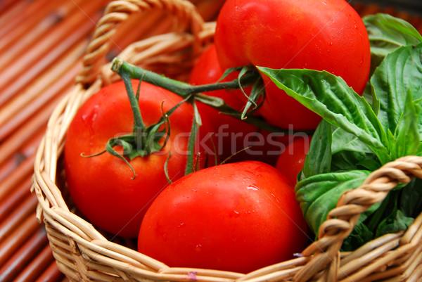 Tomatos and basil Stock photo © elenaphoto