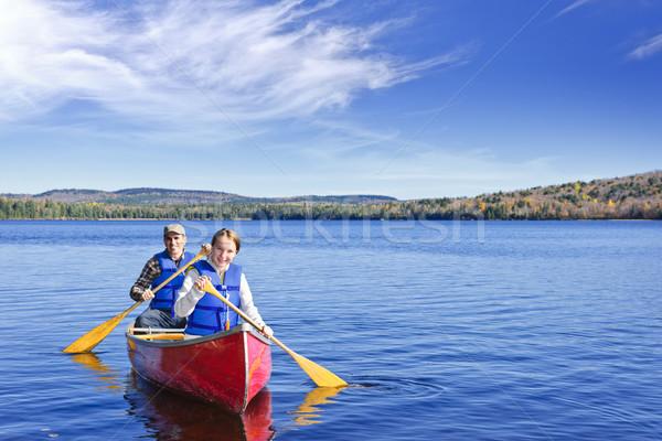 Family canoe trip Stock photo © elenaphoto