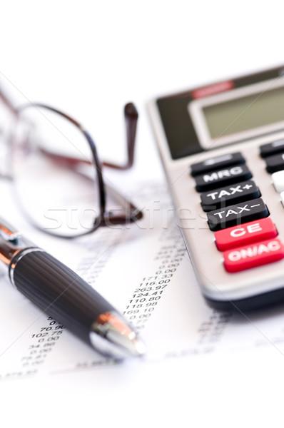 Tax calculator pen and glasses Stock photo © elenaphoto
