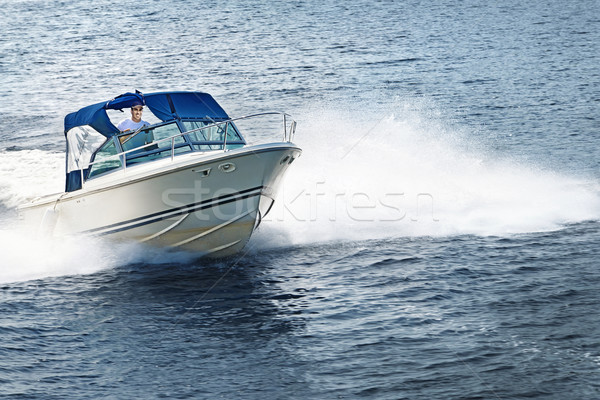 Stock photo: Man boating on lake