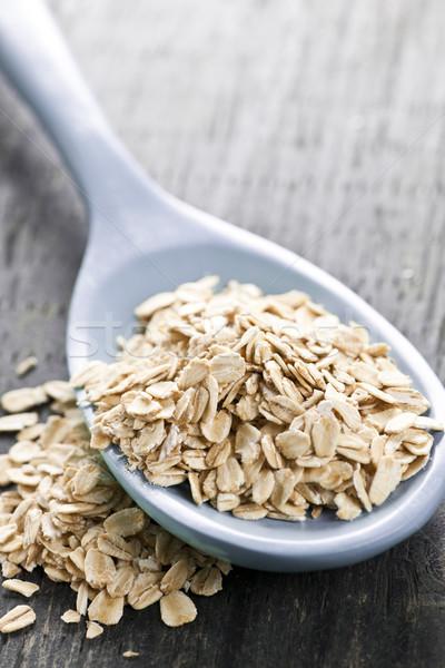 Spoon of uncooked rolled oats Stock photo © elenaphoto