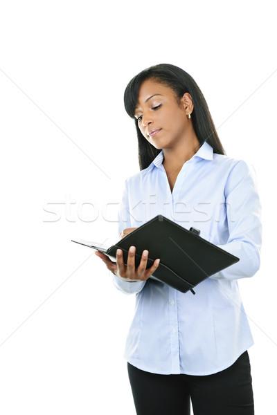 Serious woman with leather portfolio folder Stock photo © elenaphoto