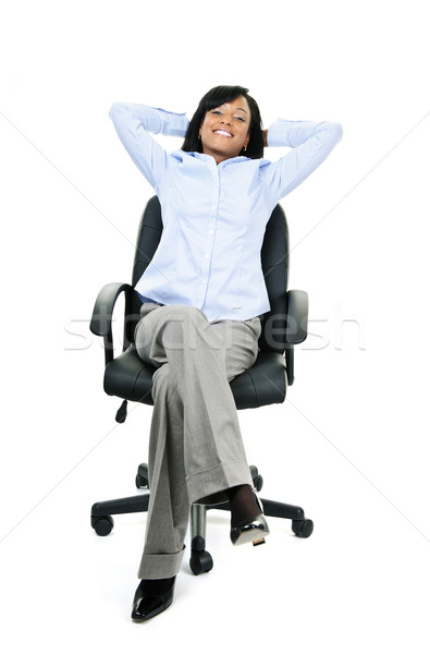 Relaxed businesswoman sitting on office chair Stock photo © elenaphoto
