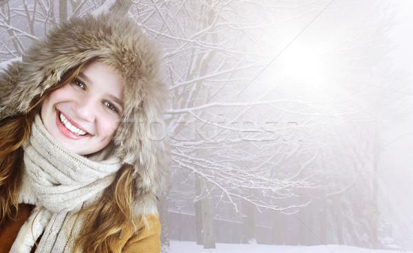 Smiling winter girl outside Stock photo © elenaphoto