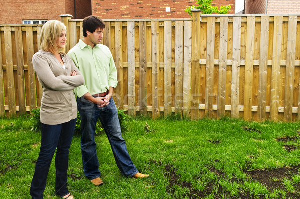 Couple concerned about lawn Stock photo © elenaphoto