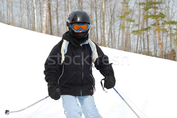 Girl skiing downhill Stock photo © elenaphoto