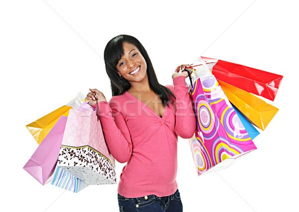 Gelukkig jonge zwarte vrouw glimlachend Stockfoto © elenaphoto