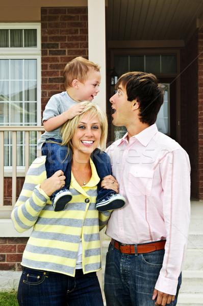 Happy family in front of home Stock photo © elenaphoto