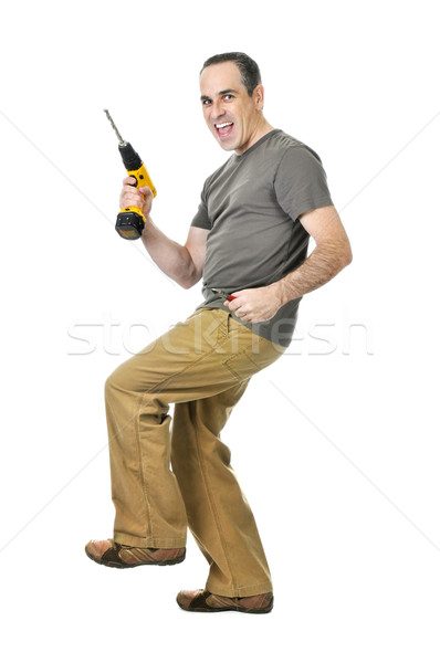 Handyman with a drill and wire cutters Stock photo © elenaphoto