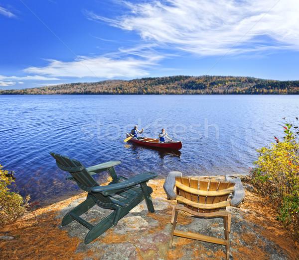 Canoeing on lake Stock photo © elenaphoto
