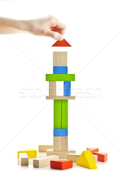 Wooden block tower under construction Stock photo © elenaphoto