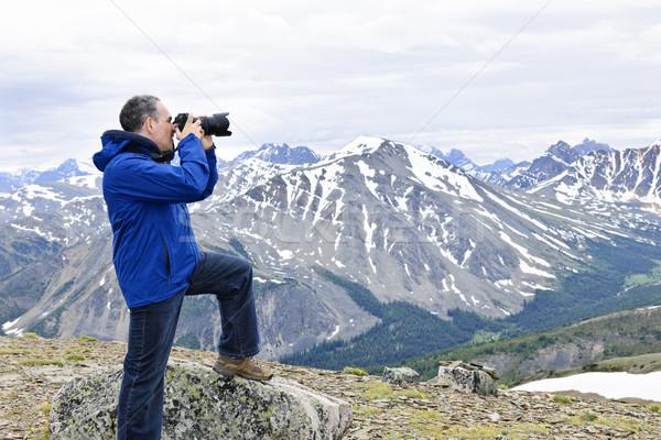 Photographer in mountains Stock photo © elenaphoto