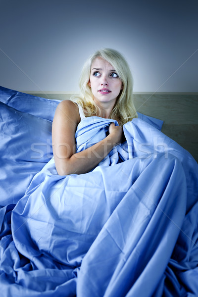 Woman scared in bed Stock photo © elenaphoto