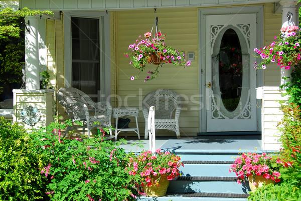 Ház veranda virágok fonott bútor virág Stock fotó © elenaphoto