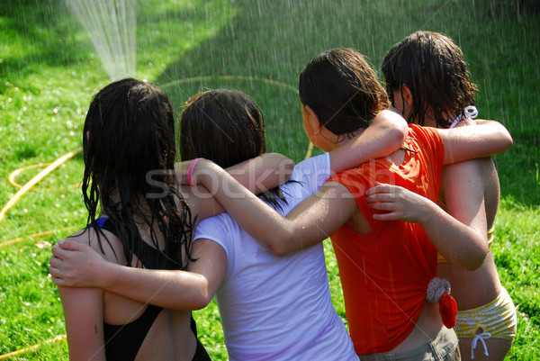 Group of girls and sprinkler Stock photo © elenaphoto