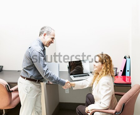 Coworkers reviewing document in office Stock photo © elenaphoto