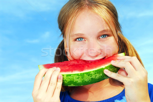 Girl with watermelon Stock photo © elenaphoto