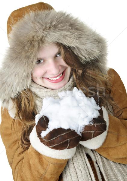Playful winter girl holding snow Stock photo © elenaphoto