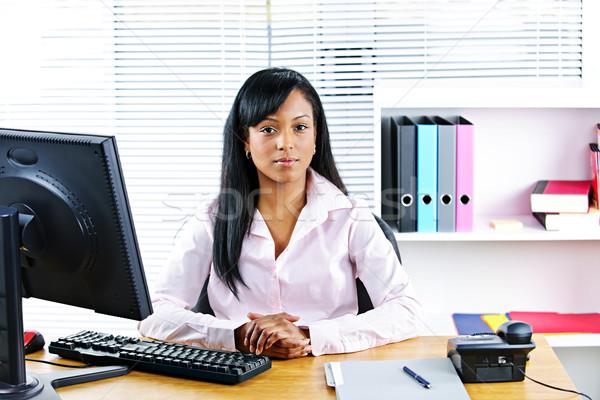 Black businesswoman at desk Stock photo © elenaphoto