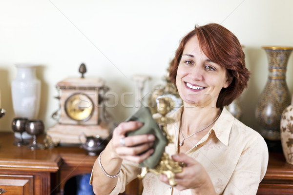 Woman polishing antiques Stock photo © elenaphoto