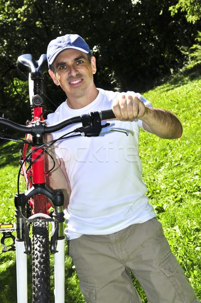 человека велосипед счастливым лет Сток-фото © elenaphoto