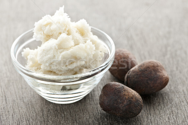 Stock photo: Shea butter and nuts in bowl