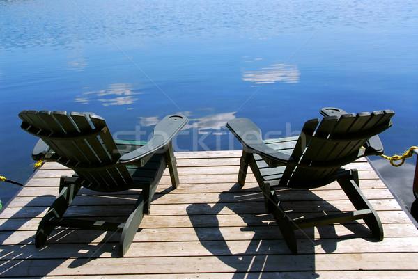 Chaises quai deux bois bleu Photo stock © elenaphoto