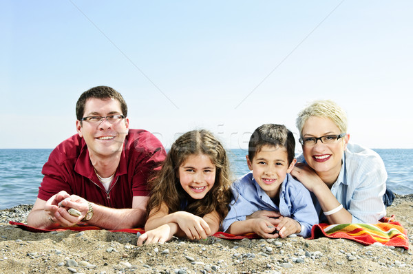 Happy family at beach Stock photo © elenaphoto