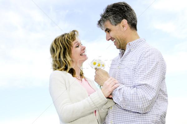 成熟した ロマンチックな カップル 花 瞬間 ストックフォト © elenaphoto