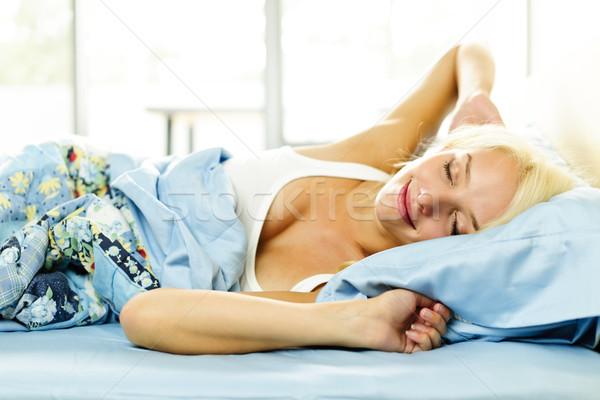Young woman waking up Stock photo © elenaphoto