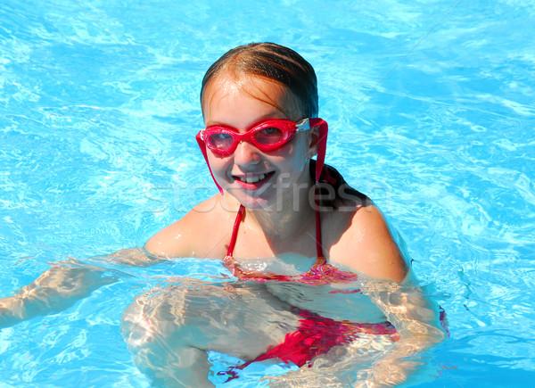 Girl swimming Stock photo © elenaphoto