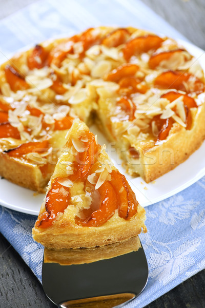 Slice of apricot and almond pie Stock photo © elenaphoto