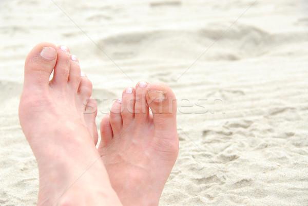 Homokos láb tengerpart textúra nők tenger Stock fotó © elenaphoto