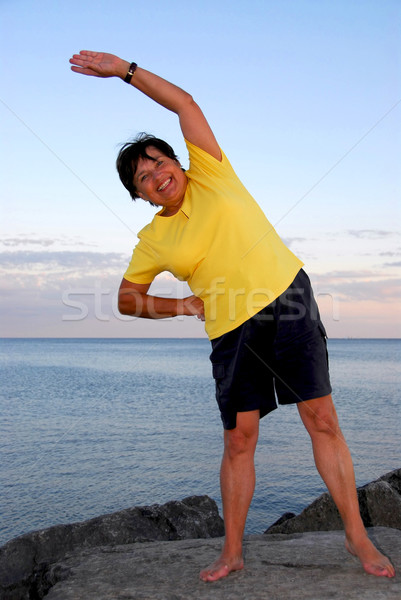 Mature woman exercising Stock photo © elenaphoto