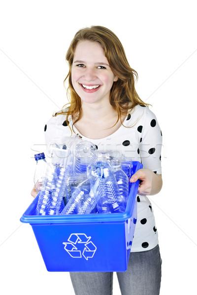 Stock photo: Young woman holding recycling box