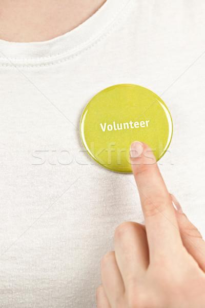 Hand pointing to volunteer button Stock photo © elenaphoto
