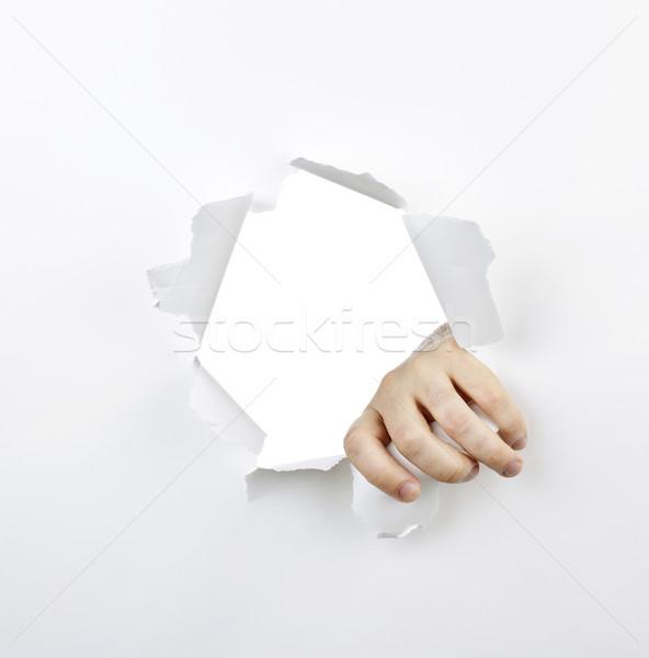 Main trou papier déchirée blanche mains Photo stock © elenaphoto