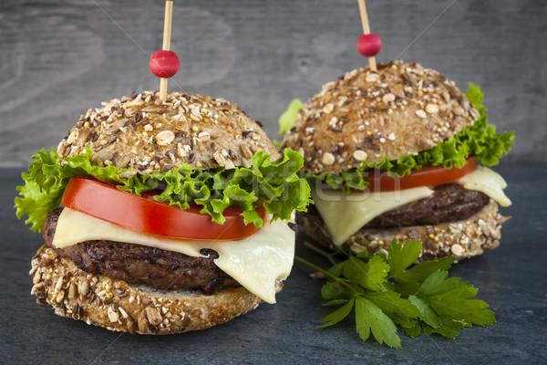 Two gourmet hamburgers Stock photo © elenaphoto