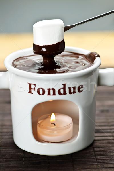 Marshmallow dipped in chocolate fondue Stock photo © elenaphoto