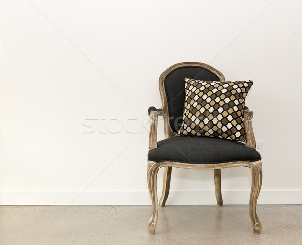 Antique armchair near wall Stock photo © elenaphoto