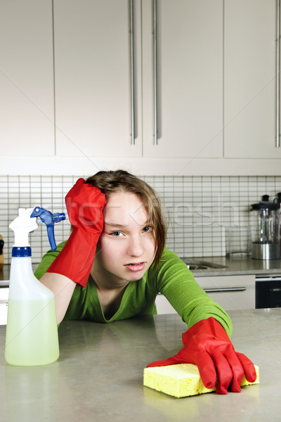 Tired girl cleaning kitchen Stock photo © elenaphoto