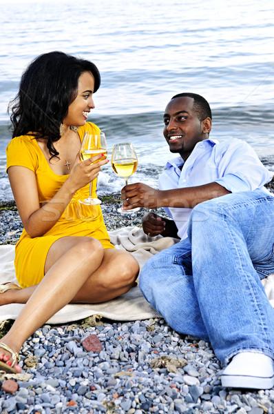 Boldog pár bor tengerpart fiatal romantikus Stock fotó © elenaphoto