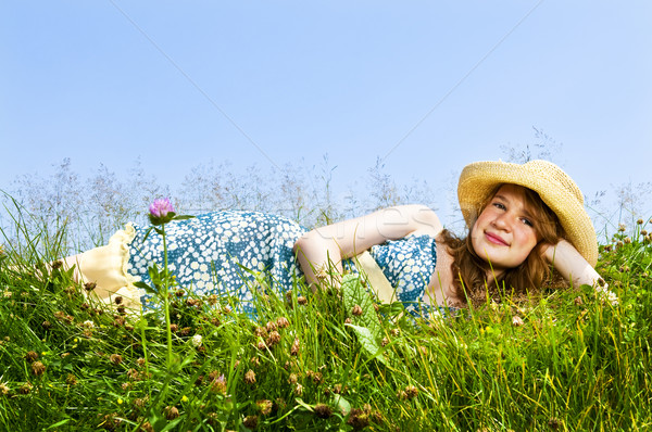 Young girl laying in meadow Stock photo © elenaphoto