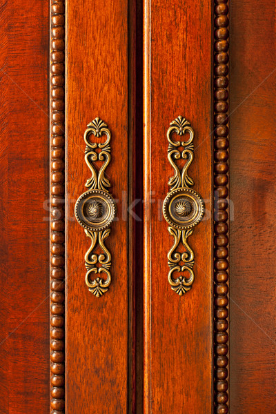 Door handles on cabinet Stock photo © elenaphoto