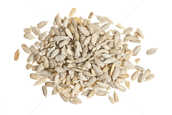 Sunflower seeds on white Stock photo © elenaphoto