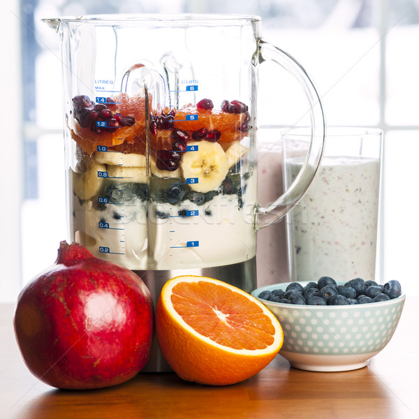 Stock photo: Making smoothies in blender with fruit and yogurt
