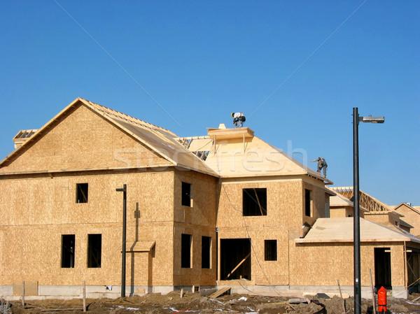 új otthon építkezés új ház munkások tető otthon Stock fotó © elenaphoto