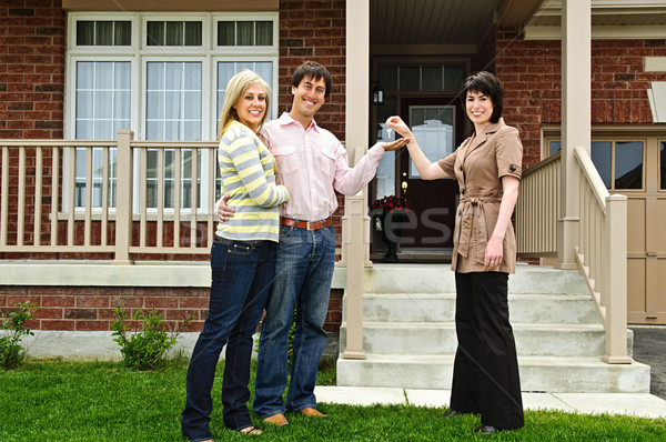 Happy couple with real estate agent Stock photo © elenaphoto