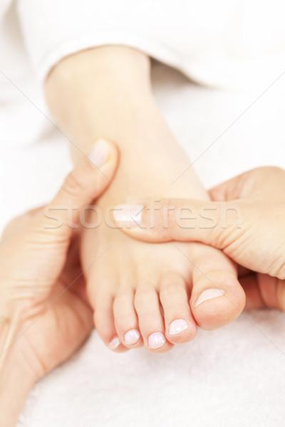 Láb masszázs női kezek puha meztelen Stock fotó © elenaphoto